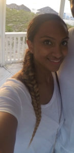 Side part, low pony tail with a fish tail braid