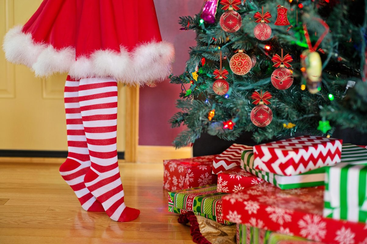 Christmas gifts under tree. Money Saving Tips for Christmas. Learn how to save money this christmas without being cheap.